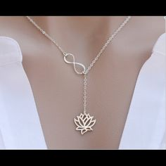 "Brand New Silver Infinity Lotus Chain Necklace Beautifully crafted brand new Silver Infinity Lotus Necklace with 925 Sterling Silver Chain. Chain Size: 14"", 16"", 18"", 20"", 22"". Traditional Chain Size is 18 inches. Let me know the chain size when you order. Jewelry Necklaces"