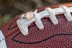 Ring on football. Incorporate hobbies, love of sports, how you met, etc. Engagement session by Claire Diana Photography
