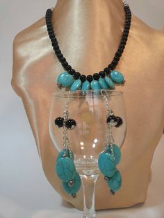 Check out this item in my Etsy shop https://www.etsy.com/listing/206549008/turquoise-and-black-necklace-and