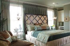 Curtains behind bed with window openings