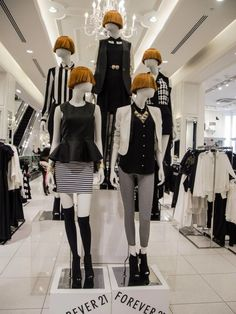 #Mannequins at Forever 21. #retail #merchandising #display #mannequin -would be cool if we could get lower tier all looking right, upper tier all looking left! -