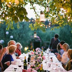 """Guests were seated at a long table which rested underneath a towering elm tree. The sun set into the rolling Tuscan hills as dinner was served. """"Delicious food just kept on coming, course after course after course,"""" recalls the bride, """"and the Chianti was truly flowing."""""""
