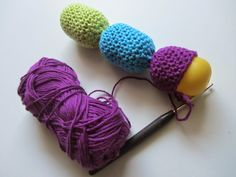 Child's rattle toy from Kinder Eggs and Crochet. Add rice or dried Chick peas to the eggs for the rattle.