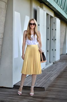 Top by Asos, skirt and shoes by Zara, bag by Louis Vuitton. (ohmyvogue.com, July 13, 2014)