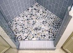 Pretty shower floor - combo of river rock & grey tile. Would be so awesome to pick a bunch of rocks at the seashore & use them to make your shower floor :)