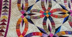 Piped binding made and completed over Labor Day Weekend.   I noticed 3 inner arcs that were missing quilting.   I took the time to load on m...
