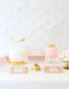 Elegant Scallop Personalized Candy Bar Wrappers from Sweet Paper Shop | Blush Pink and Gold Dessert Table | Learn more and download a FREE template to help you create this DIY Scalloped Tissue Backdrop