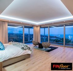 Finfloor Project Showcase: Black Forest Maplewood Mist laminate flooring.