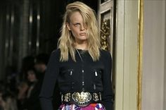 """The Spring 2014 trends that were seen on the runway this week in Milan is athletic wear. From leather running shorts to sequined track suits and baseball caps and embroidered hoodies. The designers are looking at """"pop culture icons and taking plain street wear and elevating it to luxury"""". Brands aim to shed city conservative image. -Sherese H."""