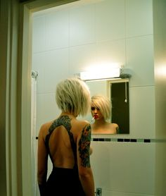 backless halter looking tattoo