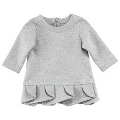 Jersey coton extensible. Manches longues. Effet plissé sur le bas de la robe. Fermeture zippée dans le dos.