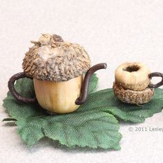 A 1:24 scale dollhouse teapot, teacup and wine goblet all made from sections of acorns.