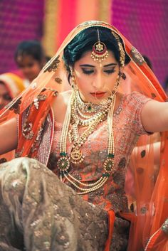 Orange and gold lehenga for gurudwara wedding #lehenga #wedmegood