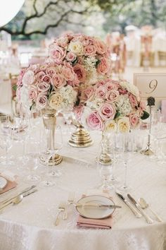 dusty rose and gold wedding centerpiece ideas with candlesticks