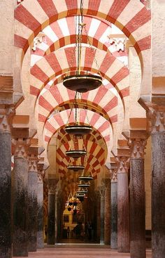 Spain - Cordoba Mezquita, a world heritage. Facts about Spain: Area: 504,783 sq km. The major part of the Iberian peninsula and Balearic Islands in the Mediterranean. Also included are the Canary Islands and the enclaves of Ceuta and Melilla on the North African coast. Population: 45,450,497. Capital: Madrid. Official language: Catalán, Galician and Basque are official languages in the respective autonomous regions. Castilian (Spanish) is the official language. Languages: 21.: