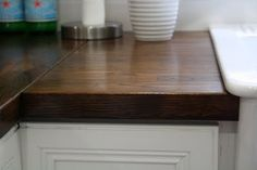 Butcher block countertops---a nice alternative and cheaper than granite. These really look nice!