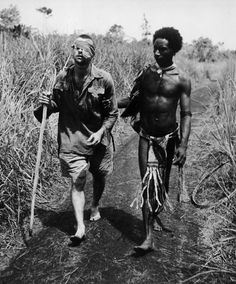 A Fuzzy Wuzzy Angel assists a wounded Australian soldier, Papua New Guinea, 1942.The Fuzzy Wuzzy Angels was the name given by Australian troops to a group of Papua New Guinean people who, during WW2, assisted and escorted injured Australian troops down the Kokoda trail. Fuzzy-Wuzzy was a British 19th century term referring to the Hadendoa warriors of the Sudan and their elaborate butter-matted hairstyles. The Fuzzy Wuzzy Angels were named for both their frizzy hair and helpful role.