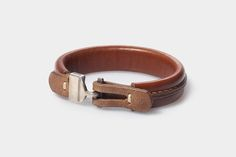Leather bracelet for men in brown color. Unusual accessory for men. It will fit for casual clothes. Fashionable and pretty.