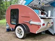 This couple had a new Teardrop trailer that he tricked out to match the Impala pull car.