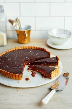 With a milk chocolate ganache, hidden dulce de leche layer and a smattering of sea salt, this might just be the ultimate chocolate tart recipe. Chocolate And Raspberry Tart, Milk Chocolate Ganache, Raspberry Tarts, Salted Chocolate, Chocolate Recipes, Chocolate Tarts, Lemon Tarts, Caramel Recipes, Tart Recipes