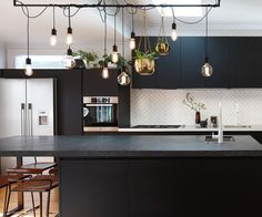 Black and white textures add drama to this light-filled kitchen