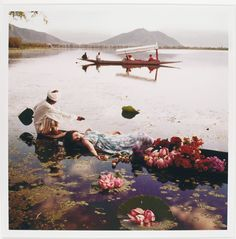 Norman Parkinson (1913 - 1990). BARBARA MULLEN, FLOATING WITH FLOWERS, KASHMIR, INDIA, VOGUE, 1956 BARBARA MULLEN, PALE COOL OF KASHMIR, INDIA, VOGUE, 1956.