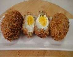 Eggs coated with spicy potato mixture, rolled in vermicelli and deep-fried.