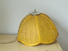 Found a yellow light fixture similar to this that would fit right into the room.