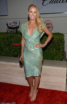 Green goddess: Joining a host of other sports stars, tennis star Caroline stood out in a stunning beaded dress as she arrived at the swanky even in Hollywood