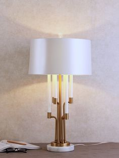 Ravello Table Lamp - A modern take on the traditional candelabra, the luxurious Ravello Table Lamp features minimal brass and marble detailing paired with a tapered drum shade. Luxury Lighting, Lighting Store, Outdoor Lighting, Decoration Lights For Home, Light Decorations, Luxury Table Lamps, Wall Lights, Ceiling Lights, Drum Shade
