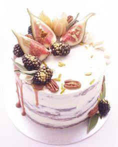 Blackberries :: like clusters of tiny jewels when you give them a gold dusting. Here they are along with some blush pink figs, physalis, sage leaves & pecans on a dark chocolate naked cake with vanilla buttercream & salted caramel drip