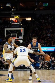 e70c0dbdd096 Nemanja Bjelica of the Minnesota Timberwolves dribbles the ball against Nick  Young and Draymond Green of