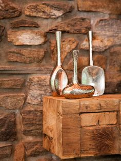Another artful mix of styles, the Scott brothers placed these funky blown-glass vases on top of a rustic wooden chest. As a result, they achieve an aesthetic that is warm, but not stuffy.