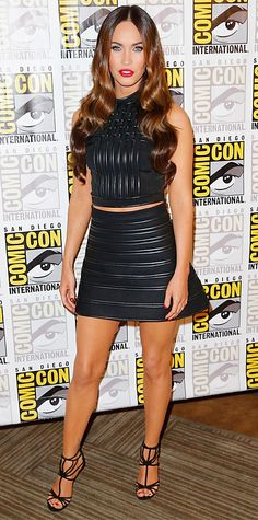 Megan Fox debuted a sexy look at 2014 Comic-Con, thanks to her fierce sculpted black leather David Koma separates and strappy Jimmy Choos.