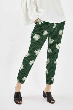 Add a touch of femininity to your smart-wear in these pretty floral spot printed trousers. In a slim, cigarette fit, they sit high on the waist and come with side tab detail. #Topshop