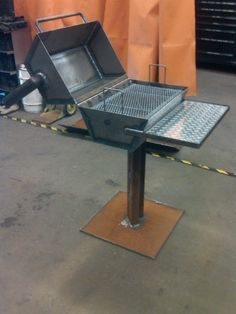Description: THE shop BBQ made and designed for burger burn fridays. Equpied with coal dump door, turn style air vent plexy glass/ diamond plate tray, hexagon style pit, and half in. plate base, good for burgers a few stakes or a couple racks of ribs. Works like a charm couldnt have built a better pit for the shop. Tools and materials used in completing project: millermatic 251,snycrowave 351LX,2x2 square stock,1/4 steel plate,1/8 expanded metal, 1 solid roun...