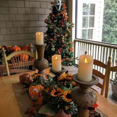 """So my husband looked at me dragging a Christmas tree out of storage and says """" A little early?"""" """"Nope. Went to Home Depot and saw a #christmastree display and a lightbulb went off."""" Decorate your tree with fall leaves. #happysaturday #thinkoutsidethebox #falldecor #halloween #fall on my #porch . #atlanta #interiordesigner #robinlamonte"""