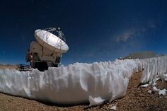 APEX's Icy Companions.  The Atacama Pathfinder Experiment (APEX) telescope — captured in this dramatic image taken by ESO Photo Ambassador Babak Tafreshi — is one of the tools used by ESO to peer beyond the realm of visible light. It is located on the Chajnantor Plateau at an altitude of 5000 metres.