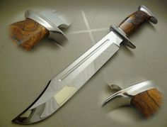 """This is a Dundee Style Bowie that I make, this one has a CPM 154 stainless steel mirror polished blade with 1/4"""" fuller, the handle is desert Ironwood & the fittings are 416 stainless steel, Overall length of this Bowie is 16"""" www.coteknives.ca - Rgrips.com"""