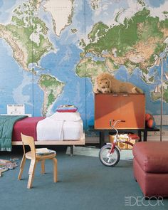 In actress Julianne Moore and Bart Freundlich's Manhattan loft, their son's room has a sense of adventure, with walls covered in a world map by Hammacher Schlemmer; the cabinet and bench are by George Nelson.   - ELLEDecor.com