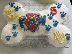 DIY Paw Patrol bone cake! Small round cakes for the sides and a trimmed down 13x9 cake in the center.