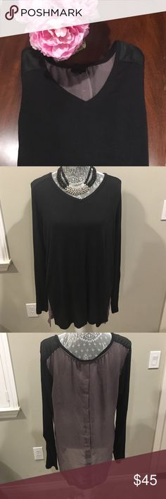 🎉HP🎉Black Blouse with Sheer Back This black blouse with sheer gray back is perfect for an evening wear! It comes in a size XL, long-sleeved, and the back is sheer. The back of the blouse is 32 inches in length and the front is 30 inches. The pit to pit measurement is 23 inches. There are a few fuzzies on this blouse in the armpit area from the dryer, but it's not too noticeable unless you raise your arm high. Necklace not for sale. Let me know if you're interested! Mossimo Supply Co Tops…