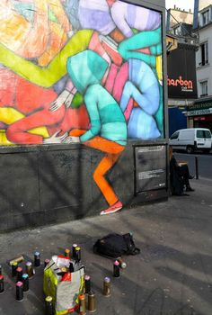 """Colorful street art by Seth Globepainter  Artist Julien """"Seth"""" Malland aka  Seth Globepainter has become known around the world for his vibrant murals of people, most frequently children, who appear to be sucked into colorful rainbow-like voids. The figures are usually facing away from the viewer, their attention completely swallowed by pools of dripping color revealed behind drab, urban facades. Seth has been active in the Parisian graffiti scene since the 1990s and has written or…"""