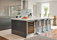 Beautiful light, open plan kitchen with clean lines. Looks out onto a private garden.