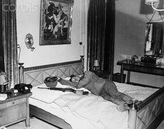Exhausted American GI Sleeping on Goering's Bed. May 2, 1945.