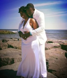 NJ Wedding Officiant Andrea Purtell, Seaside ceremony at Spring Lake Beach NJ Rock Jetty. Makes for a beautiful photo