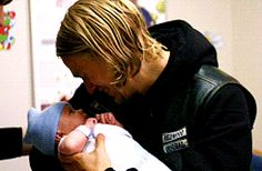 Oh sorry everyone. That's just Jax holding an infant. | Community Post: 31 Reasons Jax Teller Is Your Perfect Man