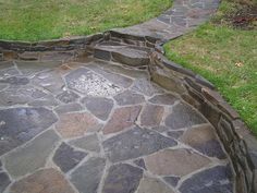 Add mortar between our flagstone for the patio and the side yard walk.  Add decorative elements in the mortar, maybe?