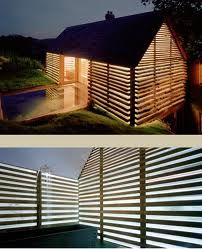 The Dairy House by Charlotte Skene Catling is the conversion of a dairy in Somerset, England into a five bedroom house. The astonishing walls are made of alternating bands of timber and glass.