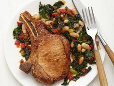 Cajun Pork Chops with Kale from FoodNetwork.com I would substitute Swiss chard for kale and add bacon. SM